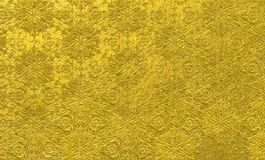 Bright gold floral background. rough golden pattern with rich gold texture. Rich golden textured background. Golden floral pattern with gold painting texture Royalty Free Stock Photography