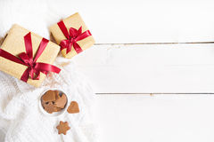 Bright gold  presents with red ribbon on wood background Stock Images