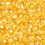 Bright golden background. Golden shiny stars. Christmas background, texture. Bright golden background. The sparkles in the form of stars. Golden shiny texture Royalty Free Stock Photos