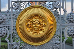 Bright golden medusa on palace front gate Royalty Free Stock Image