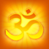 Bright golden OM symbol. Incandescent golden OM sign with rays and shine around on orange background Stock Photo