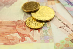 Bright golden ukrainian coins with banknots Royalty Free Stock Photography