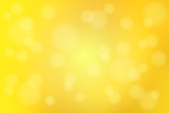 Bright golden yellow abstract with bokeh lights blurred background royalty free stock photo
