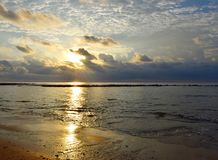 Free Bright Golden Yellow Sun At Horizon, Cloudy Sky, Calm Sea Water At Sandy Beach With Reflection Of Sunlight - Neil Island, Andaman Stock Photography - 136068222