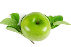 Bright green apple with leaves Stock Images