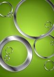Bright green backdrop with metallic circles Royalty Free Stock Photo