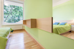 Bright green bedroom Stock Photo