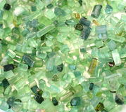 Green colour nature stones crystal. Bright green and blue nature stones aquamarine, tourmaline, beryl, geliodor crystals background stock photography