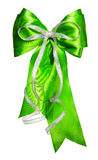 Bright green bow with silver ribbon made from silk Royalty Free Stock Photos