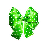 Bright green bow with white polka dots made from silk Stock Photos