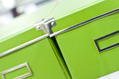 Bright green boxes. Close-up of two bright green storage boxes with metal trim detail Stock Photo