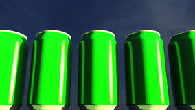 Bright green cans against sky at sunset. Soft drinks or beer for party. Beach bar. 3D rendering. Green cans at sunset. Soft drinks or beer for party. Beach bar Royalty Free Stock Photos