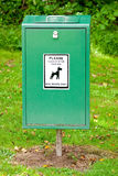 Bright Green Dog Mess Poop Bin with Label. Close Up of Bright Green Dog Mess Poop Bin with White Label stock photography