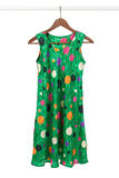 Bright green dress on a wooden hanger Stock Photo