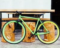 Bright green Fixed Gear beautiful vintage bicycle stands next to hipster beer pub. Bright green Fixed Gear beautiful vintage bicycle stands nex to hipster beer Royalty Free Stock Image