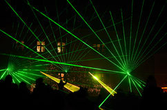 Bright green laser show with people Royalty Free Stock Images