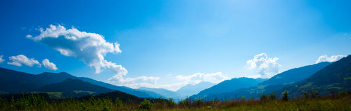 Bright green meadows and blue sky Royalty Free Stock Photography