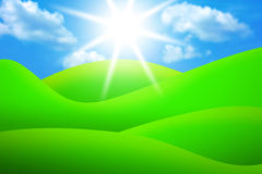 Bright green meadows, sky and sun Stock Photo