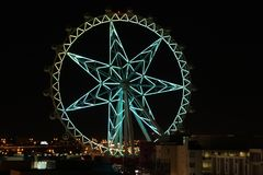 Bright Green Melbourne Star in the night sky Royalty Free Stock Images