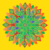 Bright green and orange mandala on the yellow background. Stock Photography