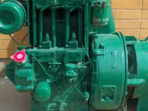 Bright green painted industrial engine. Viewed from the side with bright red tank cap Stock Photos