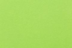 Bright green paper or carton background. stock photography