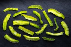 Bright green pieces of pomelo on a blue stone Royalty Free Stock Photos