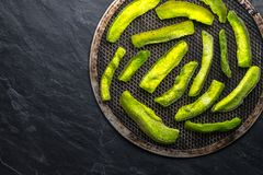 Bright green pieces of pomelo on the grill and on the blue stone free space Royalty Free Stock Images
