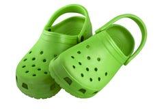 Bright green plastic clogs Stock Photo