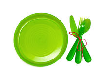 Bright green plastic tableware Royalty Free Stock Photos