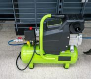 Bright green portable air compressor and accessories royalty free stock photos