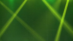 Bright green rays of light on dark green background stock footage