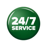 Bright green round button with words `24/7 service` Royalty Free Stock Photos