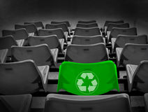 Bright green seat and recycle sign Royalty Free Stock Photo