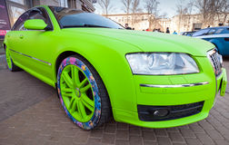 Bright green sporty styled Audi S8 car. Saint-Petersburg, Russia - April 11, 2015: Bright green sporty styled Audi S8 car stands parked on the street. Wide angle Royalty Free Stock Photography