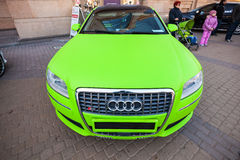 Bright green sporty styled Audi S8 car stands parked. Saint-Petersburg, Russia - April 11, 2015: Bright green sporty styled Audi S8 car stands parked on the Royalty Free Stock Photography