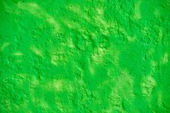 Bright green stone wall. Modern abstract painted bright green street stone wall Royalty Free Stock Photos