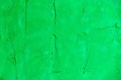 Bright green stone wall. Modern abstract painted bright green street stone wall Stock Photography
