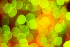 Bright green yellow bokeh lights background for celebration gree Stock Photography