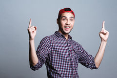 Bright guy in the studio, student, emotion, hand signs Stock Photos