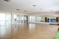 Bright gymnasium with big mirror. Empty and full of light european gymnasium with big mirror Royalty Free Stock Images
