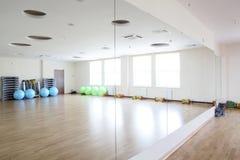 Bright gymnasium with big mirror Stock Photo