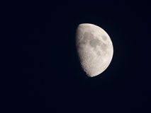 Bright half moon in the silent sky Stock Photos