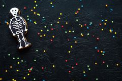 Halloween gingerbread cookies with pictures of skeleton on black background top view copyspace. Bright halloween gingerbread cookies on black background top view stock images