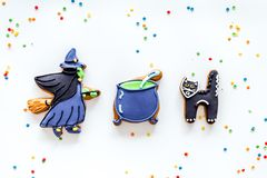 Bright halloween gingerbread cookies. Witch, cauldron and cat on white background top view copyspace Stock Photography