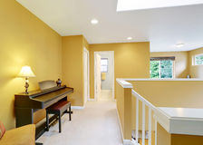 Bright hallway interior with yellow walls and piano Royalty Free Stock Photos