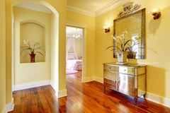 Bright hallway with shiny cabinet and flowers Royalty Free Stock Photo