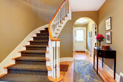 Bright hallway with wood stairs and archway Stock Images