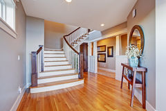 Bright hallway with wooden staircase Royalty Free Stock Images