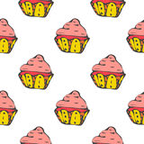 Bright hand drawn seamless patterns with cupcakes.  Royalty Free Stock Images